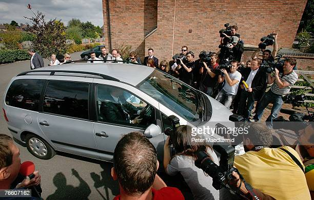 Media surround a vehicle carrying Gerry and Kate McCann as they arrive home on September 9 2007 in Rothley England The McCann family have returned...