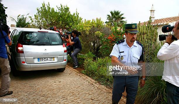 Media surround the McCann family car as it leaves the apartment in Praia da Luz with the twins September 8 2007 in the Algarve Portugal Kate and...