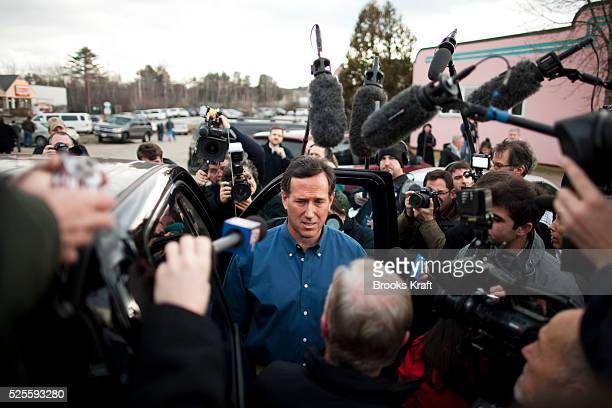 Media swarm around Republican presidential candidate Rick Santorum outside a campaign event at a diner in Tilton NH