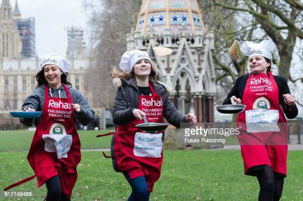 Media Team Members Georgina Prodromou Rachael Venables and Laura Hughes practice flipping their pancakes as they take part in the 21st Parliamentary...