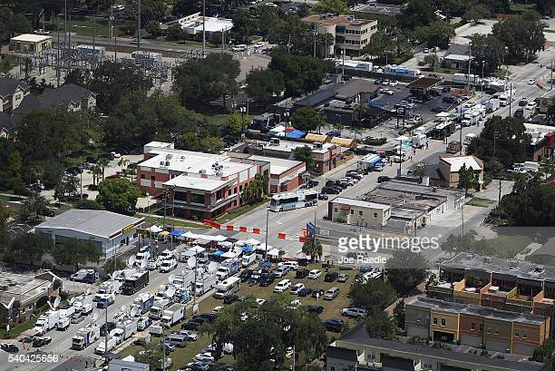 Media trucks are seen just down the street from where law enforcement officials continue the investigation at the Pulse gay nightclub where Omar...