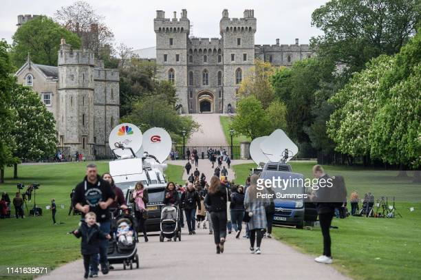 Media vans are seen on the Long Walk outside Windsor Castle after the announcement of the birth of the Duke and Duchess of Sussex's baby on May 6,...