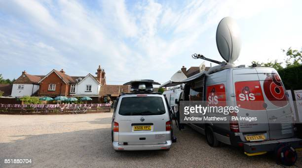 Media vans gather in the car park of the Cottage Inn in Upper Bucklebury where villagers are having a party to celebrate the birth of the Duke and...