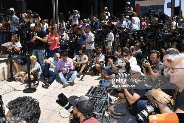 Media wait for Real Madrid's Portuguese forward Cristiano Ronaldo to hold a press point after appearing before a court in Pozuelo de Alarcon a...