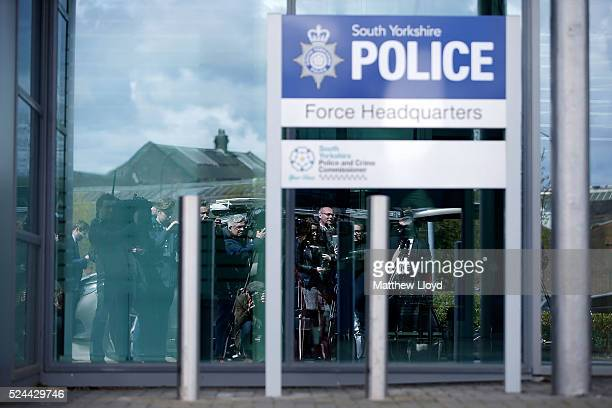 Media wait for South Yorkshire Police Chief Constable David Crompton to make a statement to the media outside the Force's headquarters on April 26,...