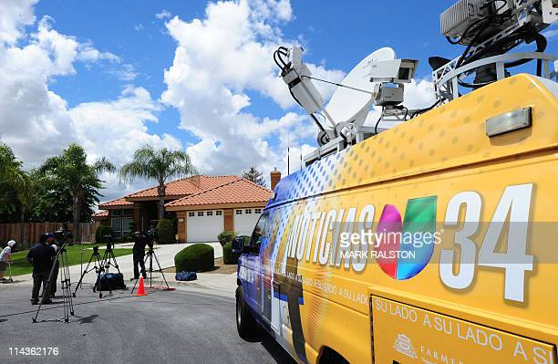 Media wait outside the home of Mildred Patricia Baena, the former maid who mothered a child by actor and former Californian Governor Arnold...