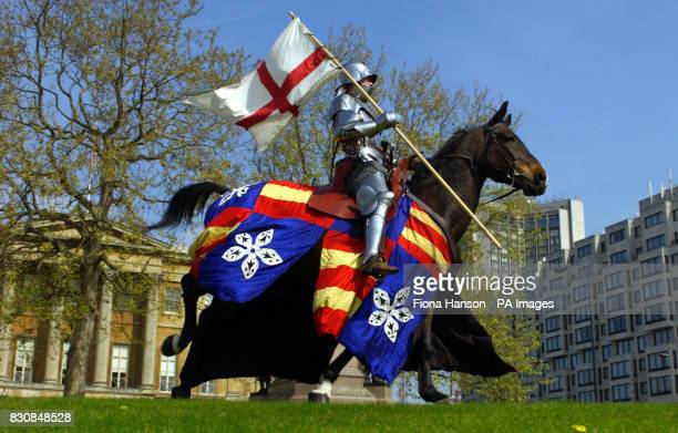 A 'Mediaeval Knight' alias Dominic Sewell from Peterborough riding Tequila flies the St Georges flag across London's Hyde Park Corner on St Georges...