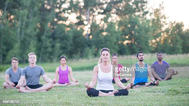 mediating peacefully at the park - mediation stock pictures, royalty-free photos & images