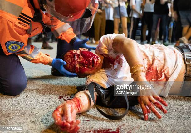 A medic attends to an injured protester during the demonstration Hong Kong Protest entered its 16th straight weekend More demonstrations have...