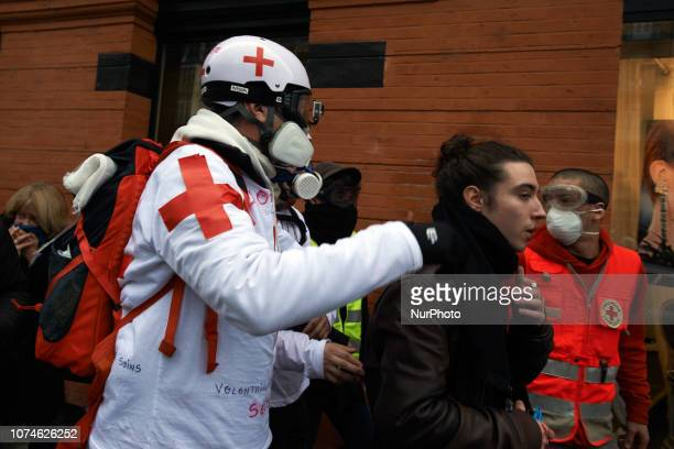 A Medic guides a injured man to a place where Medics can cure him Act VI dubbed 'Revolt' of the Yellow Vest movement begun peacefully but the protest...
