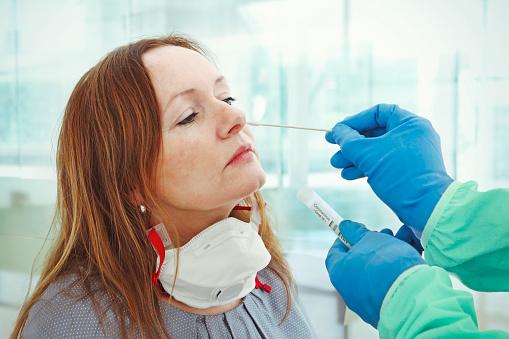 Medic taking sample for coronavirus testing 1215463252