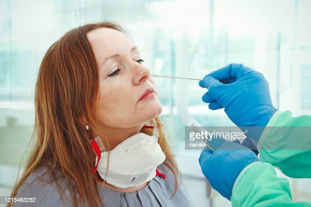 medic taking sample for coronavirus testing - cotton stock pictures, royalty-free photos & images