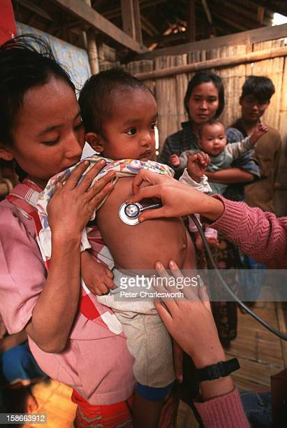 Medic uses a stethescope to check a small child at a clinic in a Karen refugee camp north of the Thai town, Mae Sot. Camps in this area are filled...