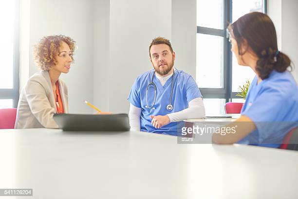 medical administrator with staff