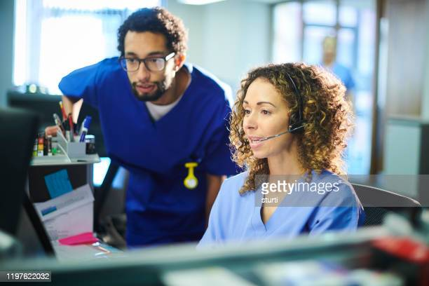 medical advice team - nhs stock pictures, royalty-free photos & images
