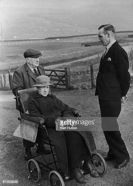 Medical Aid Secretary C L King equips a patient with a free bathchair in Wales 27th April 1946 Medical aid is free to the elderly in Wales Original...