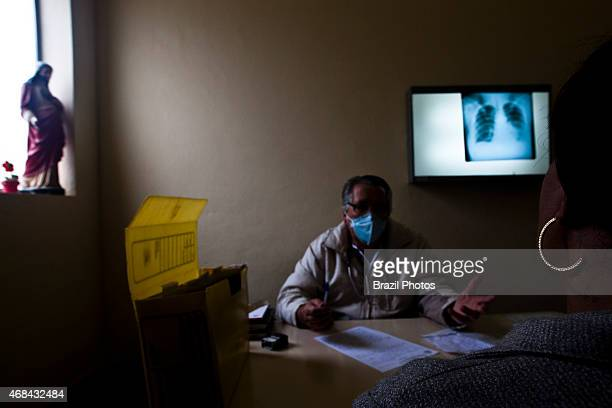 Medical appointment Doctor Claudionir Pereira Guimaraes wears mask while talking to a transvestite tb patient that is HIV positive in Gutembergue dos...