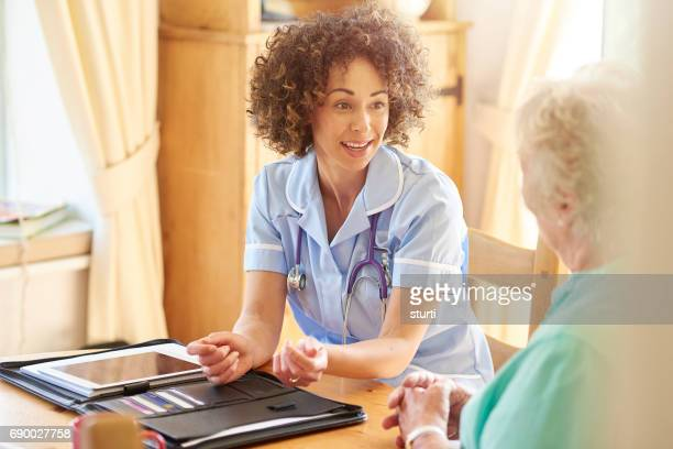 medical assessment at home - house call stock photos and pictures