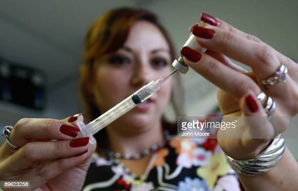 Medical assistant Elissa Ortivez draws an MMR vaccination at the Spanish Peaks Outreach Clinic on August 5 2009 in Walsenburg Colorado The Spanish...