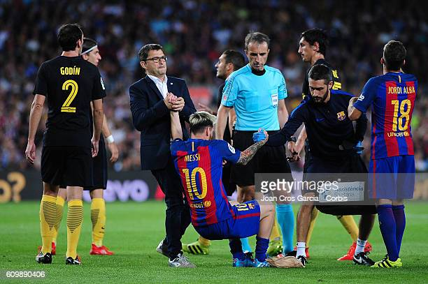 Medical assistants of FC Barcelona attend to Lionel Messi during the Spanish League match between FC Barcelona vs Club Atlético de Madrid at Camp Nou...