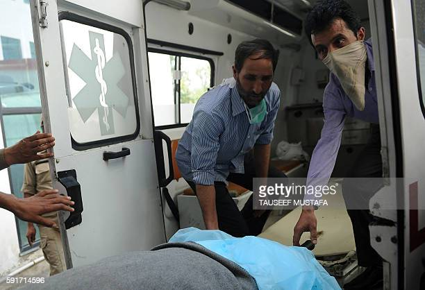 Medical attendants carry the mortal remains of Kashmiri youth Shabir Ahmed into an ambulance at The Government Medical College in Srinagar on August...