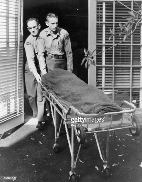 Medical attendents removing the body of Marilyn Monroe from her home