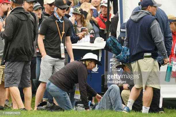 Medical attention is administered after an incident involving a golf cart on the 16th hole during the second round of the 2019 U.S. Open at Pebble...