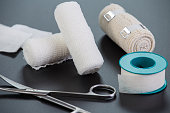Medical bandages with scissors and sticking plaster