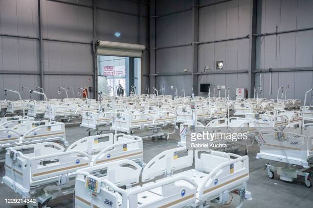 Medical beds are set up inside of field hospital built in an exhibition center for patients who suffer the coronavirus disease on October 22, 2020 in...