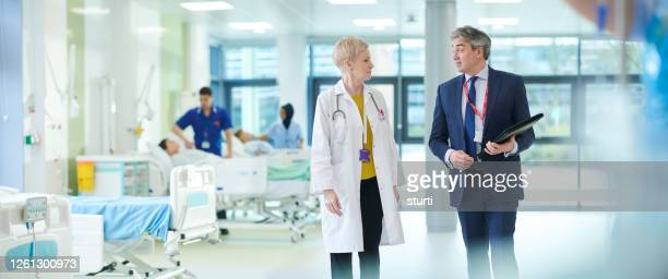 medical business meeting - wide shot stock pictures, royalty-free photos & images