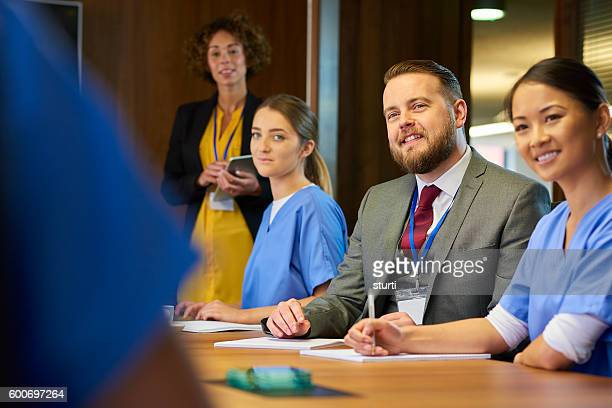 medical business meeting - nhs staff stock pictures, royalty-free photos & images