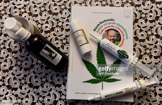 Medical cannabis oils lay on a book about doctor Marek Bachanski in a home of the Schewe family on October 30 2017 in Siedlce central Poland The...