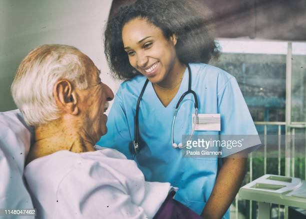 medical care  concept. nurse assisting patient in hospital - dementia stock pictures, royalty-free photos & images