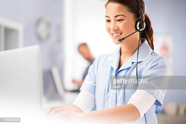 medical centre receptionist on the phone
