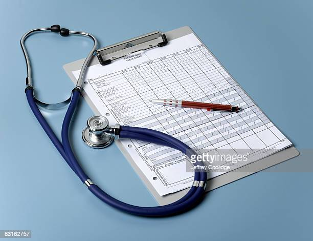 Medical chart and stethoscope