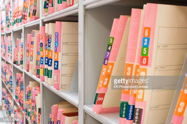Medical charts on shelf in file room
