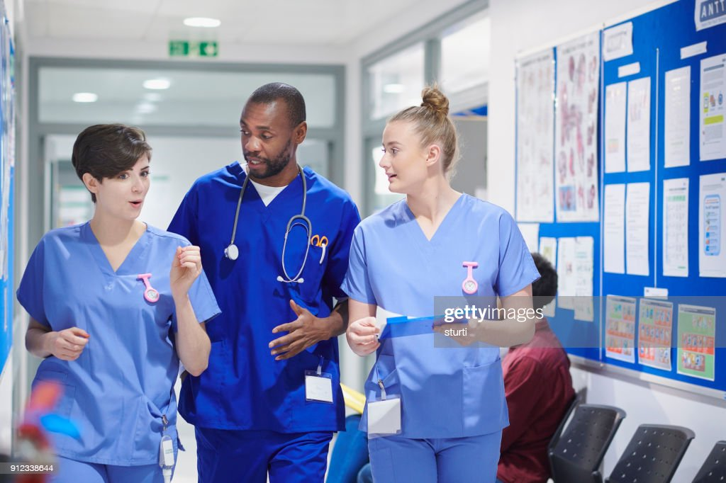 medical clinic team walking : Stock Photo