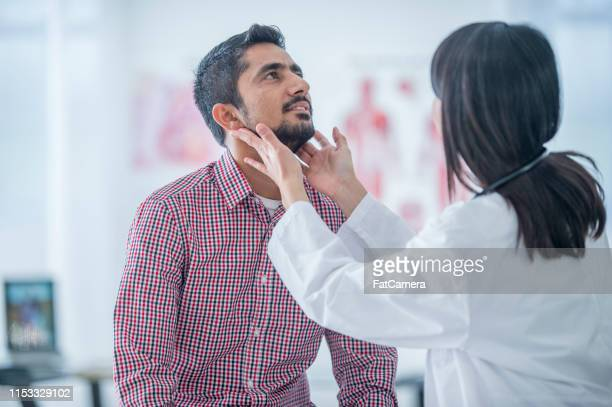 medical consulation - throat stock pictures, royalty-free photos & images