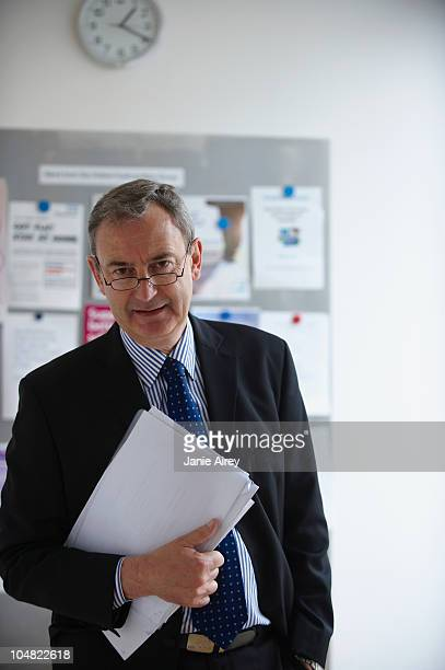 medical consultant holding paperwork - formal businesswear stock pictures, royalty-free photos & images