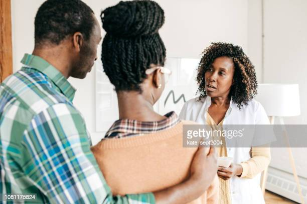 medical consultation - nigerian men stock photos and pictures