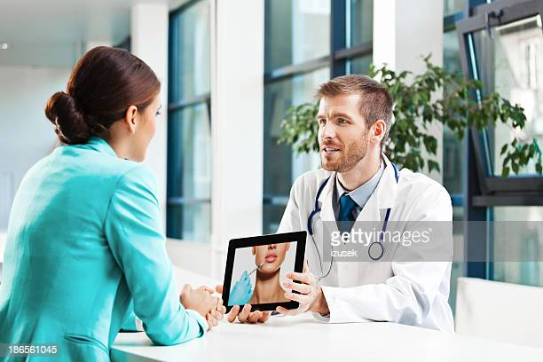 medical consultations - botox stock pictures, royalty-free photos & images