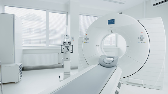 Medical CT or MRI or PET Scan Standing in the Modern Hospital Laboratory. Technologically Advanced and Functional Mediсal Equipment in a Clean White Room. 1074166156