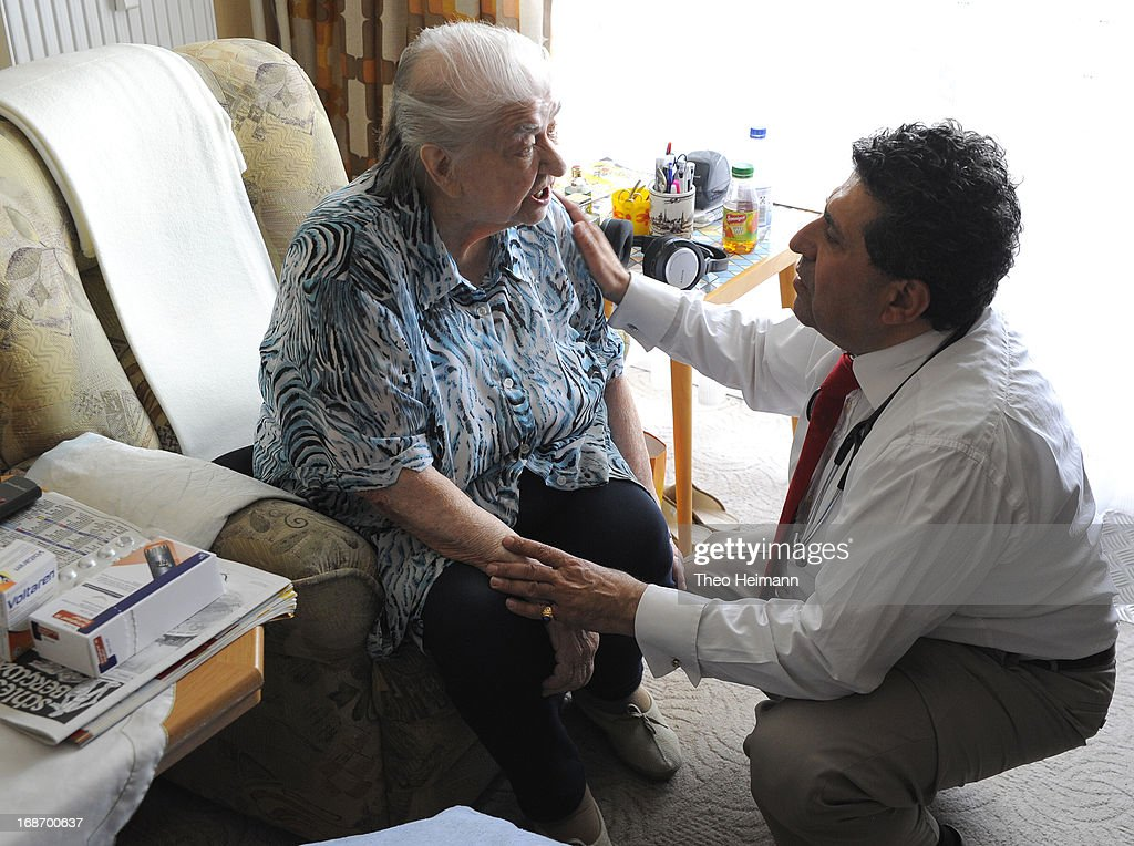 Medical doctor Amin Ballouz tends to Charlotte Wiese, 93, who suffers from high blood pressure, during a housecall on April 30, 2013 in the village of Gartz an der Oder near Schwedt, Germany. Ballouz was born in Lebanon and moved to Germany as a child, and has had a general practitioner's practice in the small, east German town of Schwedt since 2010. Many of his patients are elderly and live in small villages in the region around Schwedt and Ballouz travels daily in one of his five Trabant cars to pay housecalls. Eastern Germany faces a chronic shortage of country doctors to serve rural communities.