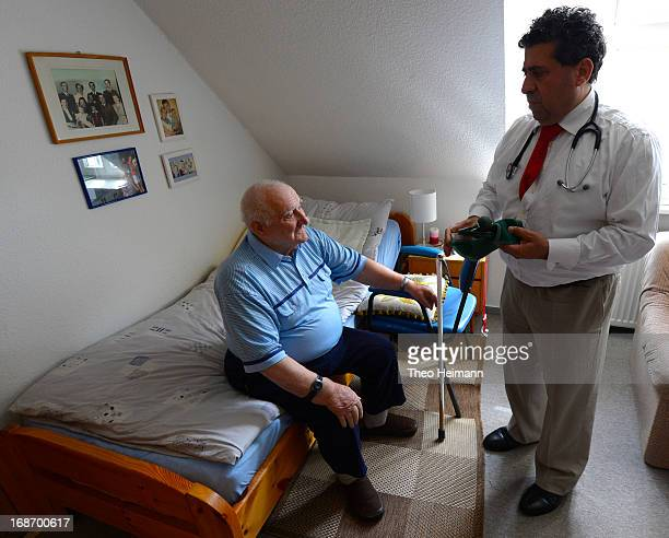 Medical doctor Amin Ballouz tends to Paul Hoeff who sees poorly and suffers from high blood pressure during a housecall on April 30 2013 in the...