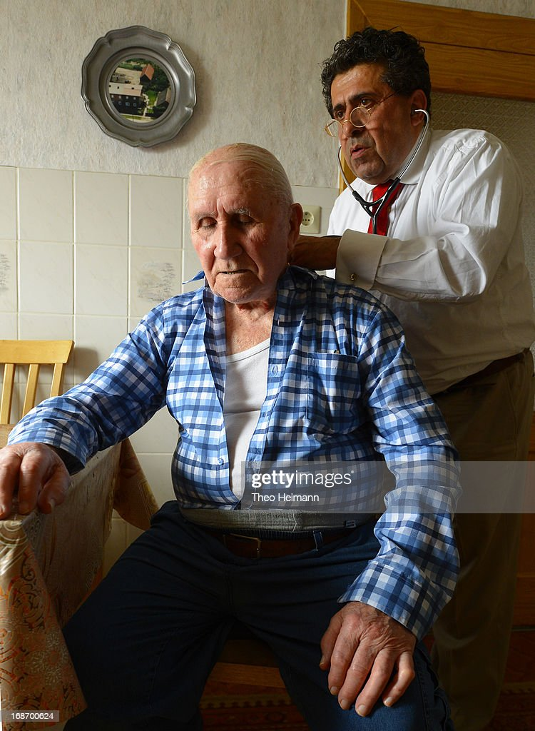 Medical doctor Amin Ballouz uses a stethoscope to listen to the breathing of Wladislaw Krause, 90, during a housecall on April 30, 2013 in the village of Gratz an der Oder near Schwedt, Germany. Ballouz was born in Lebanon and moved to Germany as a child, and has had a general practitioner's practice in the small, east German town of Schwedt since 2010. Many of his patients are elderly and live in small villages in the region around Schwedt and Ballouz travels daily in one of his five Trabant cars to pay housecalls. Eastern Germany faces a chronic shortage of country doctors to serve rural communities.