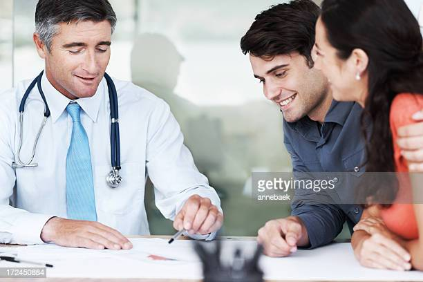 Medical doctor talking to couple