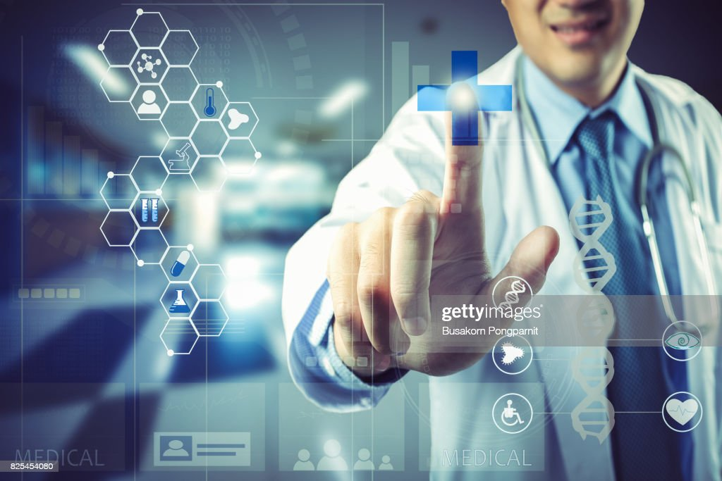 Medical doctor touching virtual interface button of healthcare application : Stock Photo