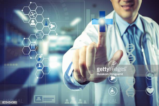 medical doctor touching virtual interface button of healthcare application - molecules stock photos and pictures
