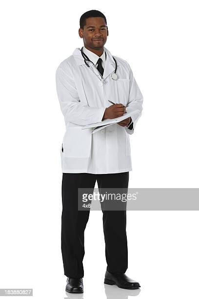 Medical doctor wearing lab coat writing notes