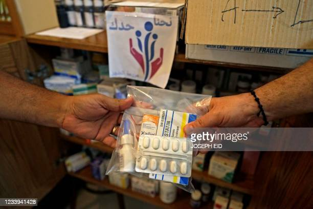 """Medical drugs are exchanged at the house of a Lebanese volunteer of the """"We Are By Your Side"""" initiative in the village of Mazraat el-Dahr in Mount..."""
